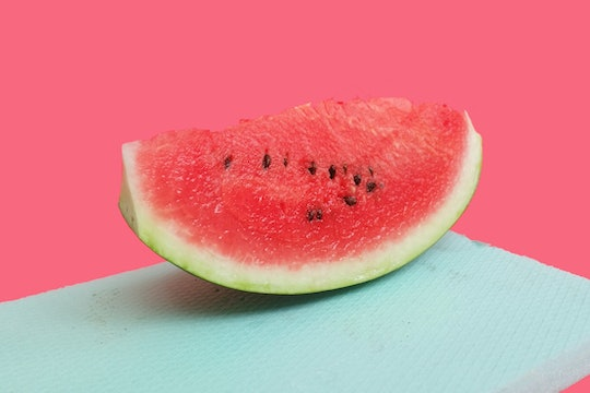 watermelon against pink and blue background