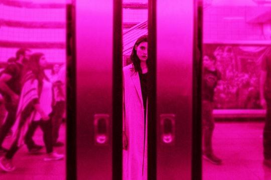 Woman behind closing subway doors