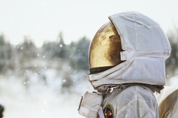 A person in a space suit in a snowy field