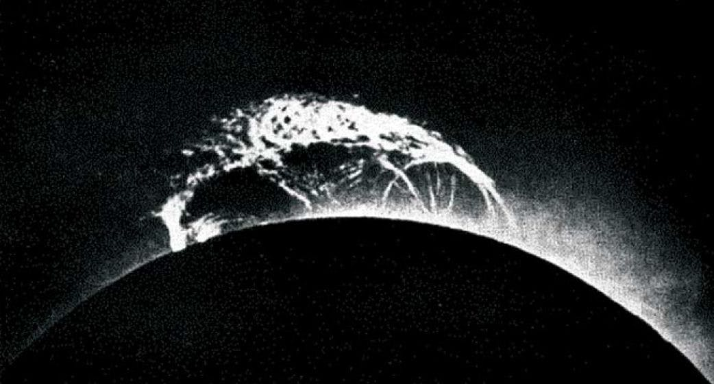 A solar prominence over the sun during the 1919 solar eclipse.