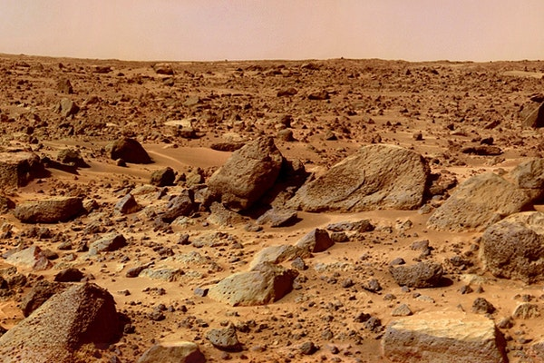 a rocky surface of mars with a pink hazy sky