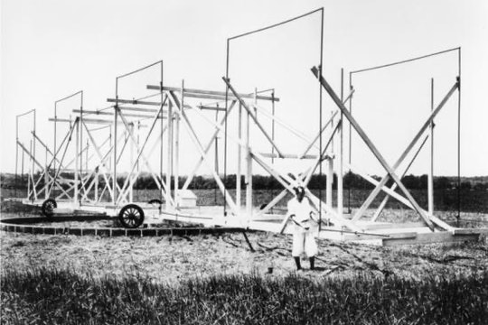 Jansky with his antenna, which was more than 100 feet long and 20 feet tall and rotated on four Ford Model-T wheels