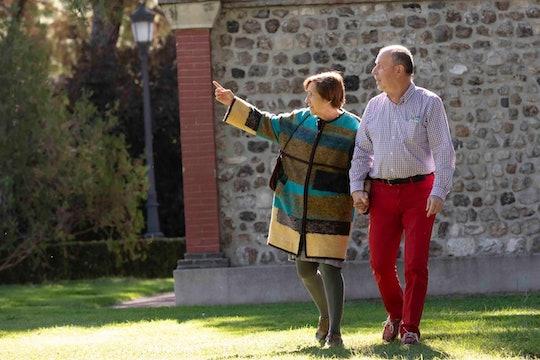 Alicia Del Blanco and Armando Guerra take a daily walk in El Retiro park in Madrid, Spain