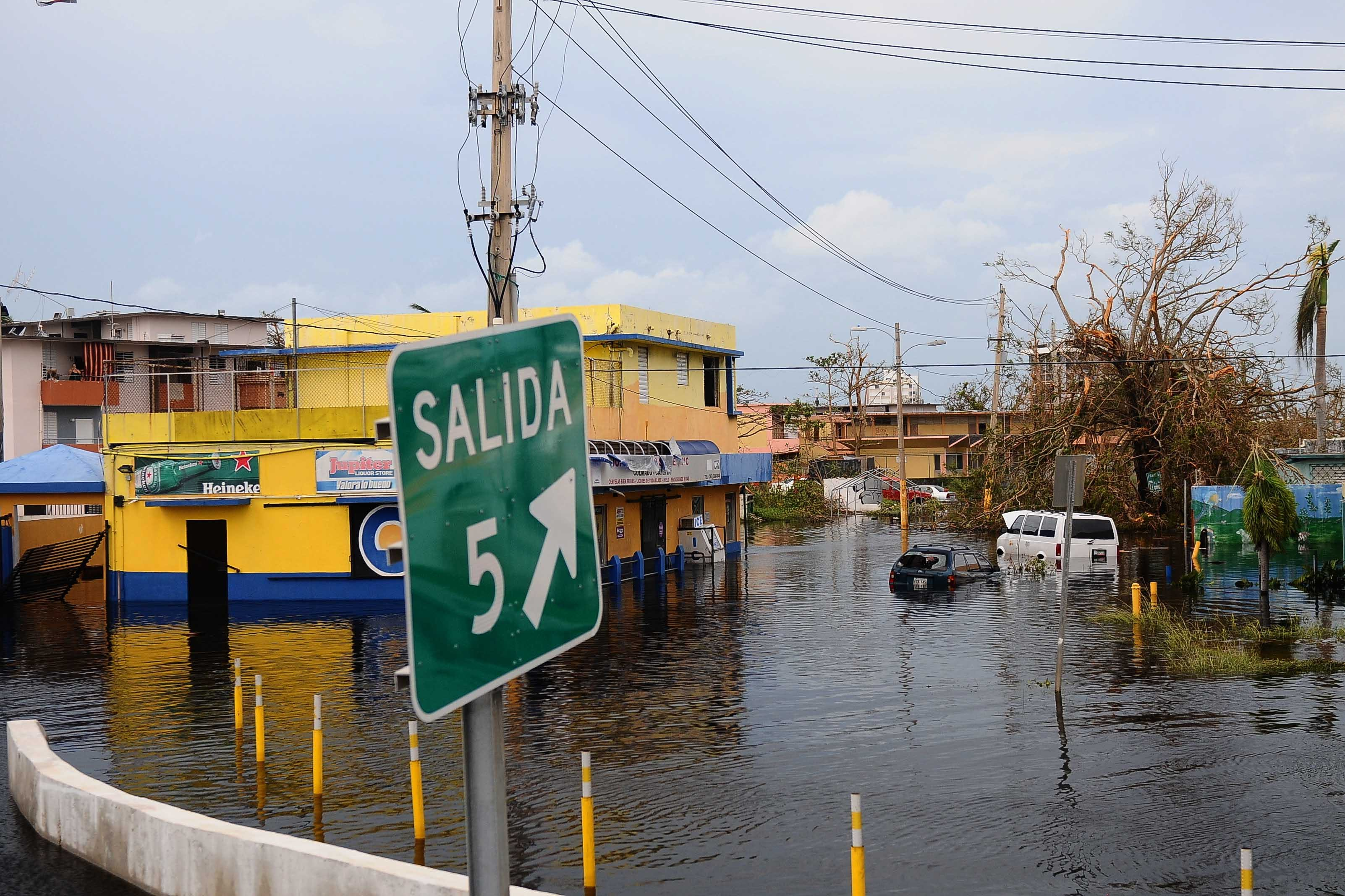 Flooded streets in a town in PR in the aftermath of Hurricane Maria