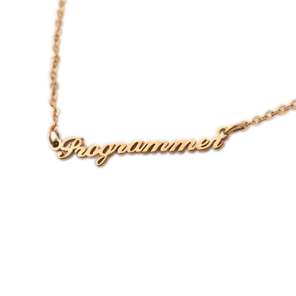 "A nameplate necklace that reads ""Programmer."""
