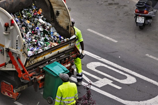 Garbage truck filled with plastic bottles