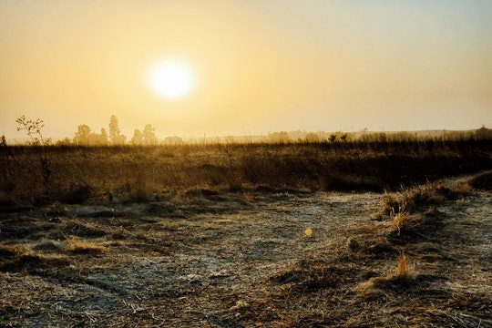 The setting sun highlights a dusty haze that lingers in the San Joaquin Valley.
