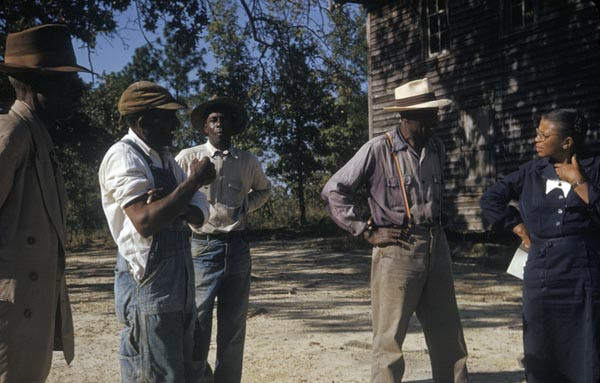 Human test subjects from the Tuskegee Syphilis Study talking with a study coordinator, Nurse Eunice Rivers
