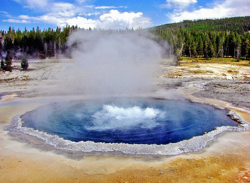 hydrothermal pool with blue water