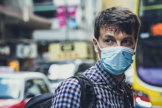 A man wearing a facemask to protect himself from viruses or bacteria, like coronavirus.