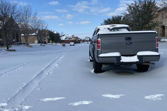 A large pick-up truck in the snow in Texas