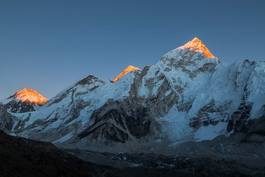 himalayan mountains with light shining just on the tops of the peaks