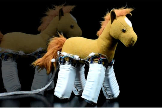 A soft child's horse toy with robotic skin around it's legs
