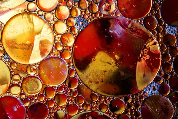 an abstract of gold and brown bubbles of different sizes
