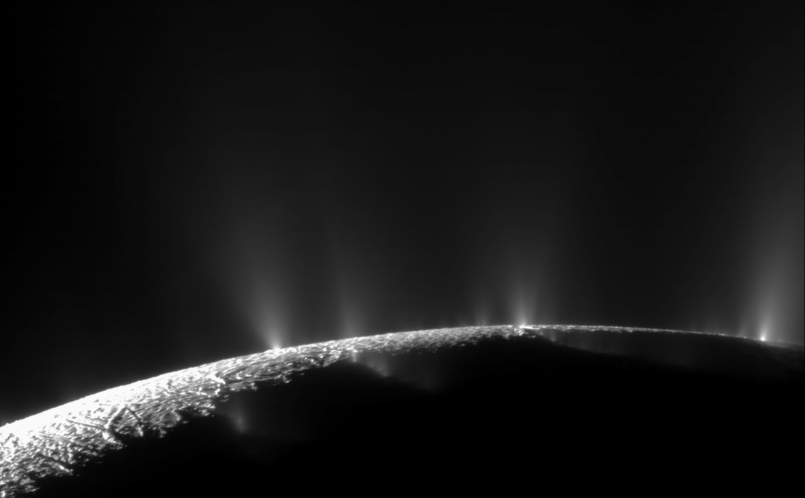 Geysers erupting on the surface of Enceladus, photographed by Cassini