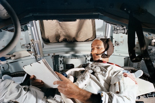 Command Module pilot Michael Collins practices in the CM simulator on June 19, 1969, at Kennedy Space Center.