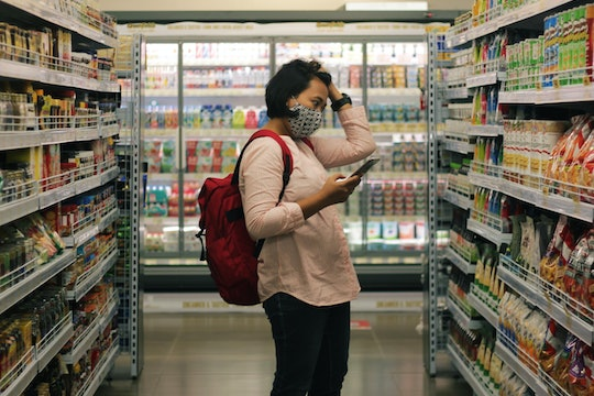 A woman shopping at a grocery store