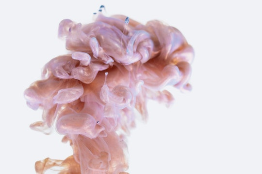 a plume of something pink that looks like a brain on a white background