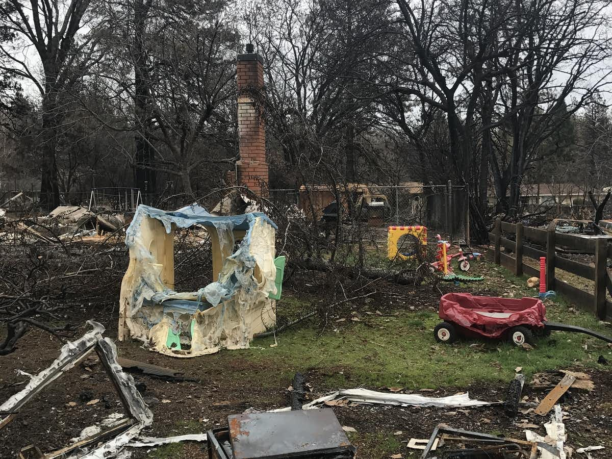 Plastic toys left behind in a yard to melt in a wildfire