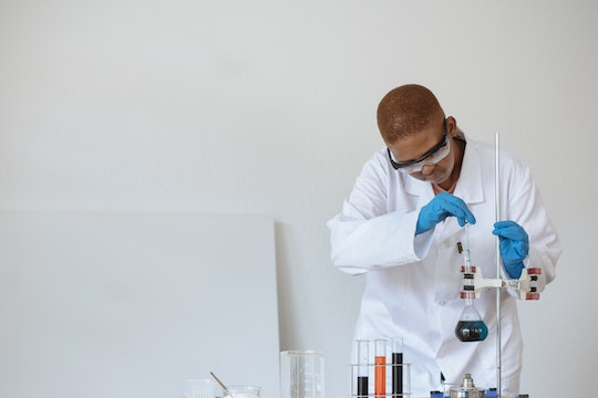 a black chemistry student running an experiment (#BlackInChem)