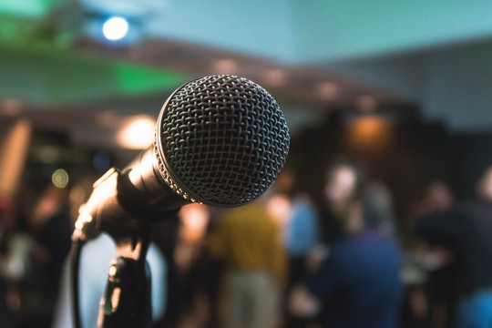 microphone speaking stage people
