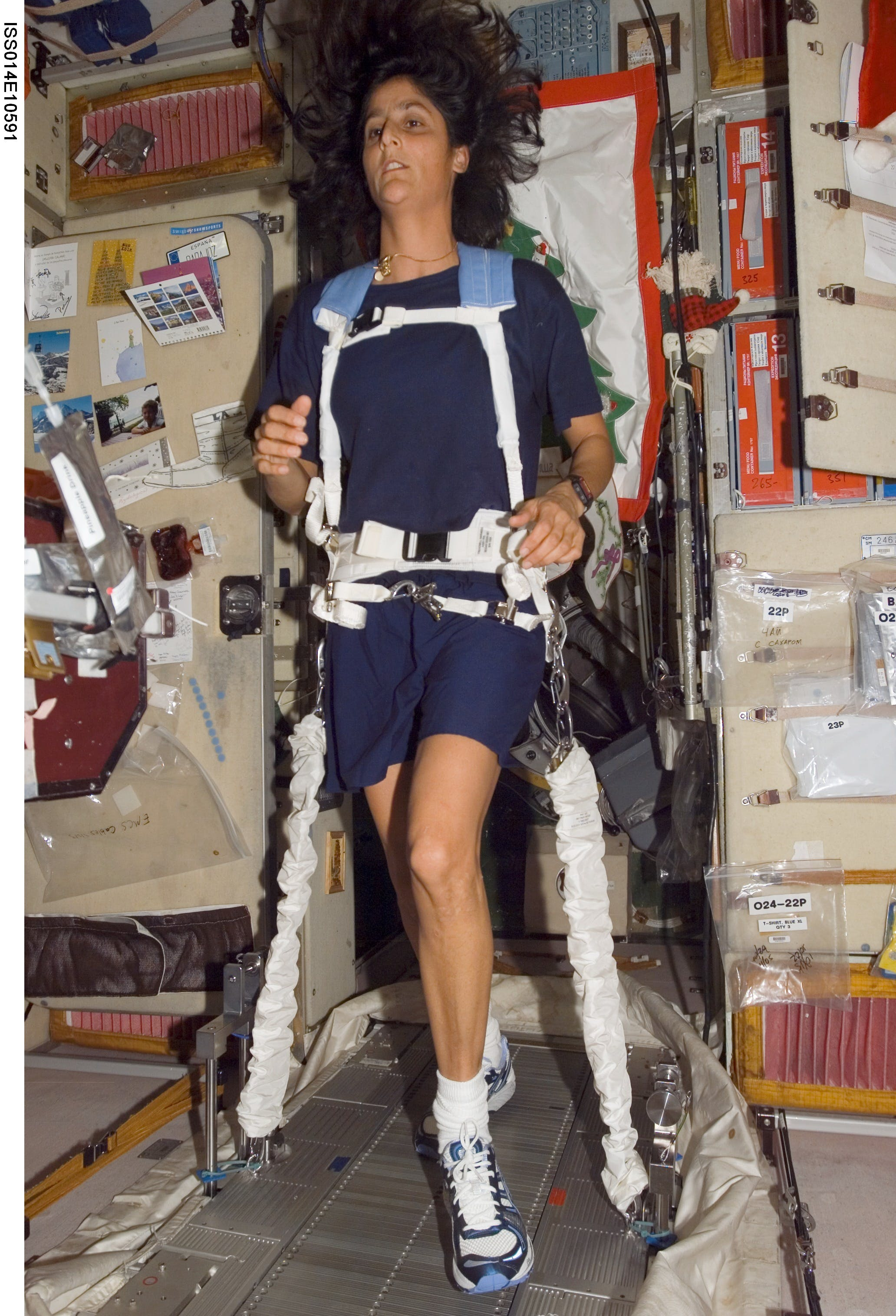 An astronaut exercising in space