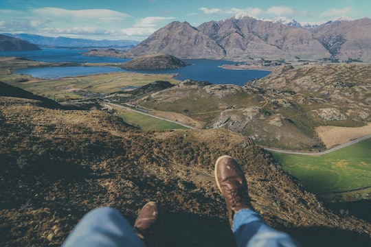 person's feet and mountains in the background