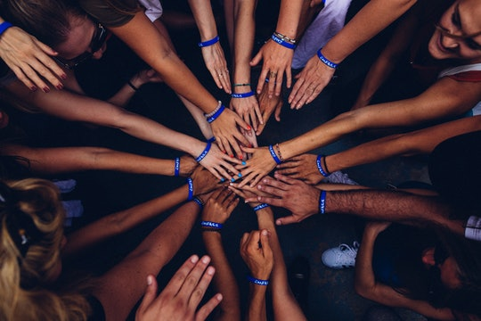 Collection of hands meeting in a circle.