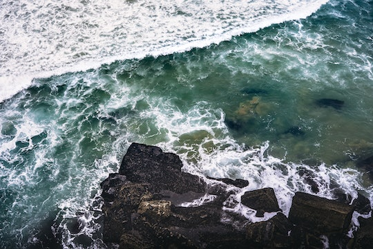 wave crashing on a rocky coast, picture taken from above
