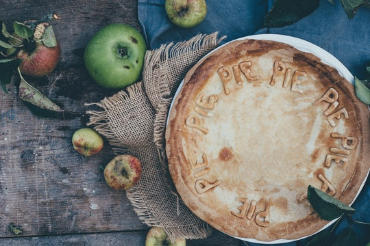 """A pie with the word """"pie"""" written in a circle all around the crust."""