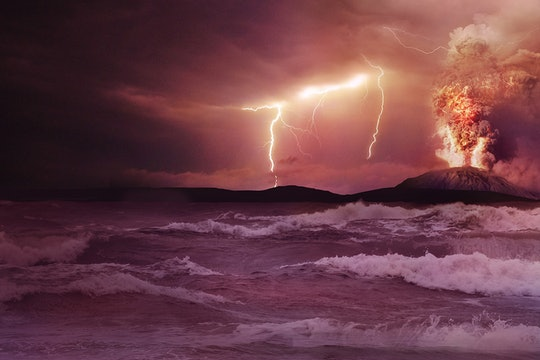 lighting and an erupting volcano over the ocean