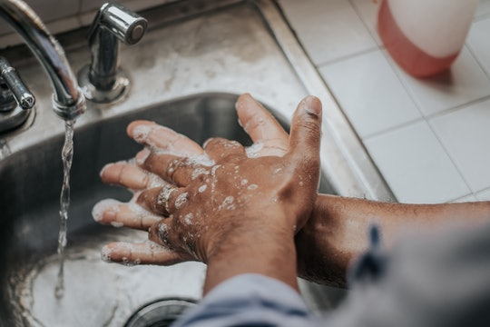soapy hands under a faucet