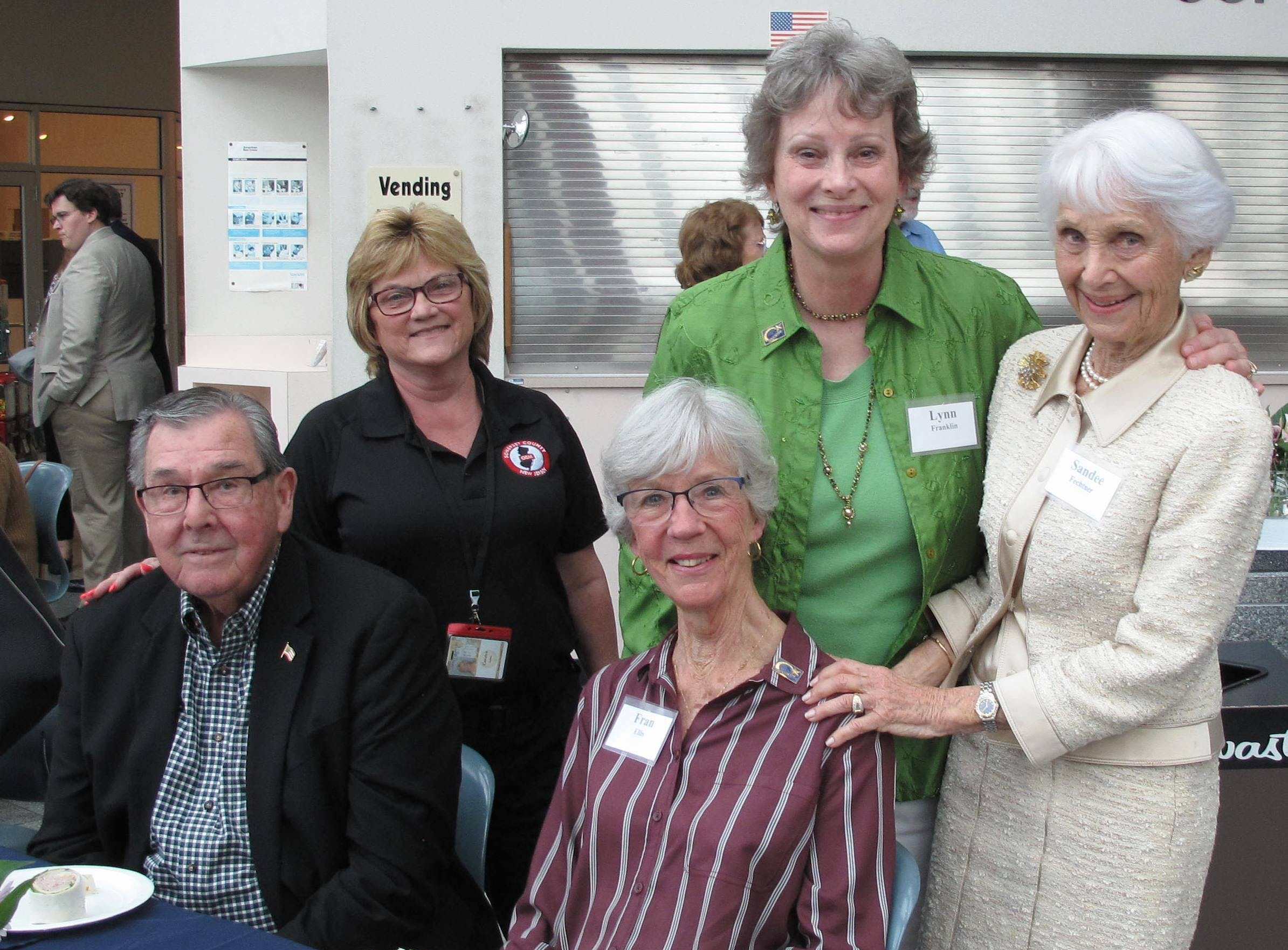 Lynn Franklin (in green), volunteer president of the Kaleidoscope of Hope Foundation.