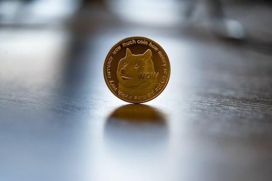 A dogecoin coin sitting on a table