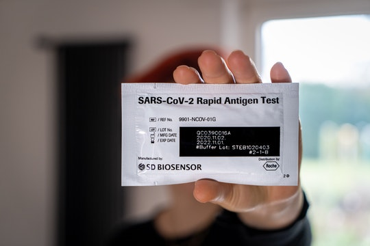 A person holding a rapid antigen COVID-19 coronavirus test
