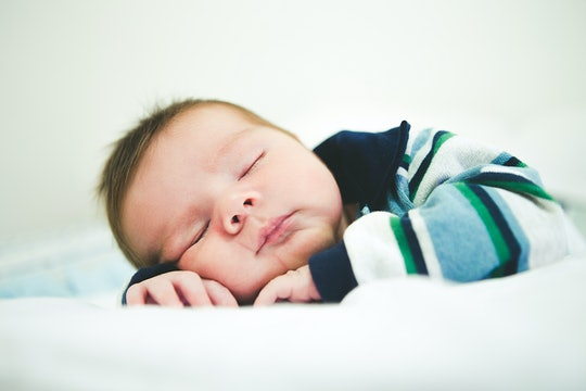 sleeping baby in a striped shirt