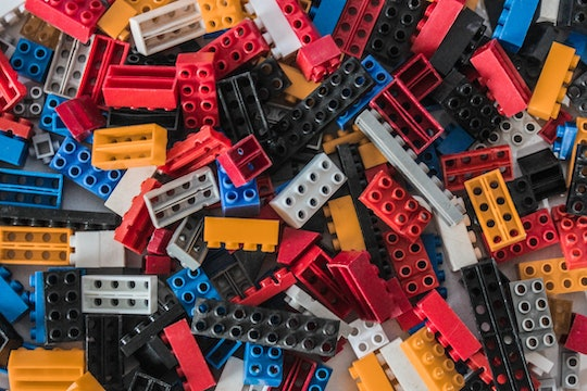 Assorted LEGO pieces of different sizes and colors