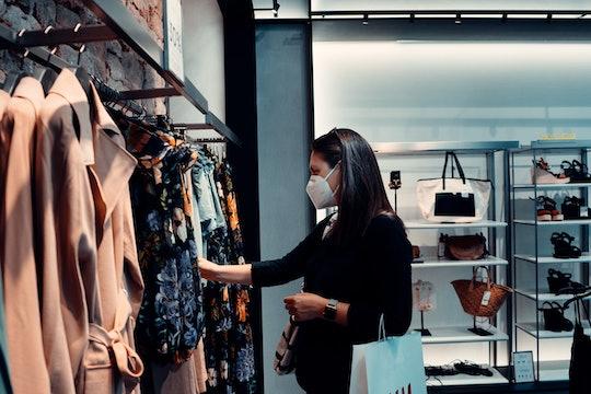 A customer shopping at a clothing store