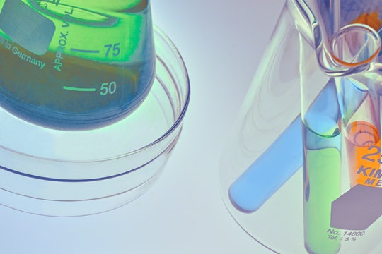 test tubes with green, blue, and orange liquid in them