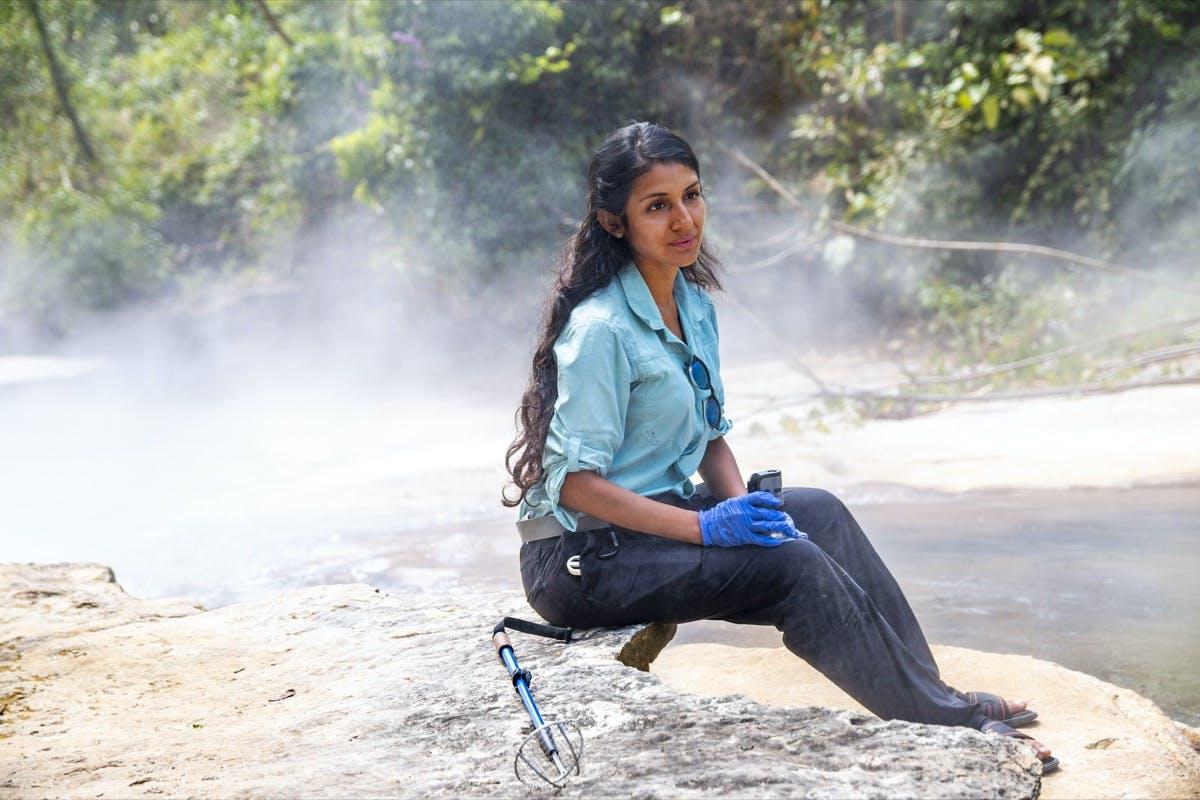 Rosa Vásquez Espinoza sitting near the Amazon's Boiling River