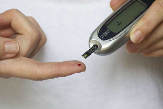 A diabetic pricking their finger for a blood test